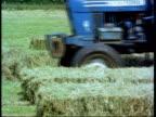 Tractor baling hay, England, UK