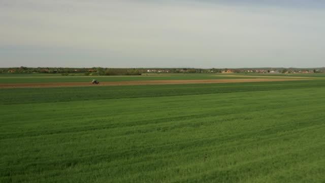 AERIAL Tractor harrowing the field
