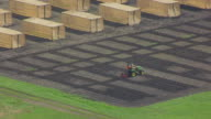 WS AERIAL POV Tractor in front cultivating land / Ames, Iowa, United States