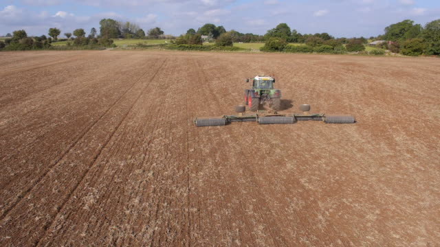 Tractor Ploughing Field, Aerial View