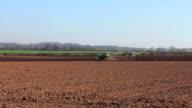 Traktor ploughing field