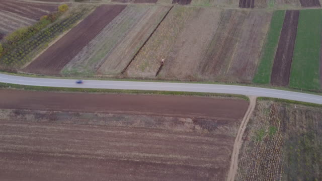 Tractor working on field 4k