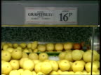 Trade figures **** FOR Italy = RAI ENGLAND London Grapes grapefruit and Cox apples on sale in supermarket Interview Supermarket spokesman SOF new...