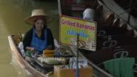 Trader on boat at Damnoen Saduak Floating Markets, Bangkok, Thailand, Southeast Asia, Asia
