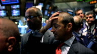 Traders Discuss the Impact the Economic Crisis Has Made on the New York Stock Exchange