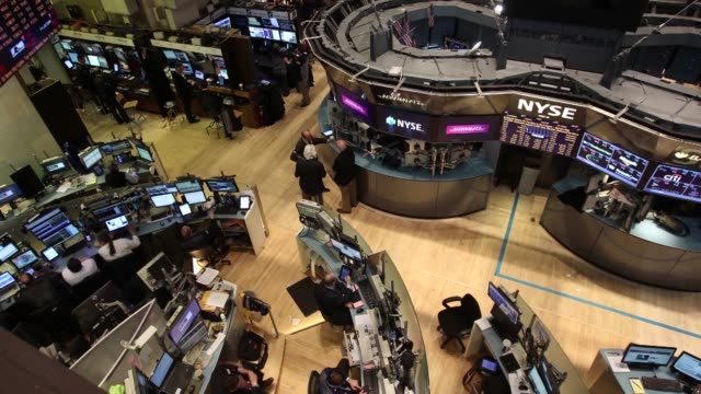 Traders work on the floor of the New York Stock Exchange in New York U S on Tuesday March 11 Wide shot of traders on the floor of the NYSE Wide shot...