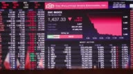 Traders work on the floor of the Philippine Stock Exchange in the Makati district of Manila the Philippines on Monday May 2 Signage for the...