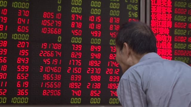 Trading is halted for 15 minutes on Chinas stock markets after shares fell more than five percent triggering an automatic circuit breaker