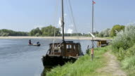 Traditional boat on the river Loire and a boat crossing over the river