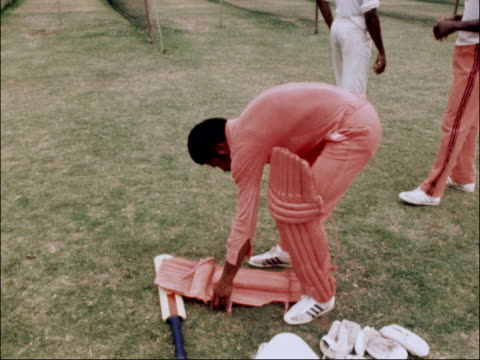 Traditional cricket under threat AUSTRALIA Sydney EXT Kerry Packer pats Clive Lloyd / West Indians in salmon pink bowl into nets / WI captain wears...