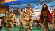 MS Traditional dancers at tourist show with waiters and music AUDIO / Abbia Ababa, Ethiopia