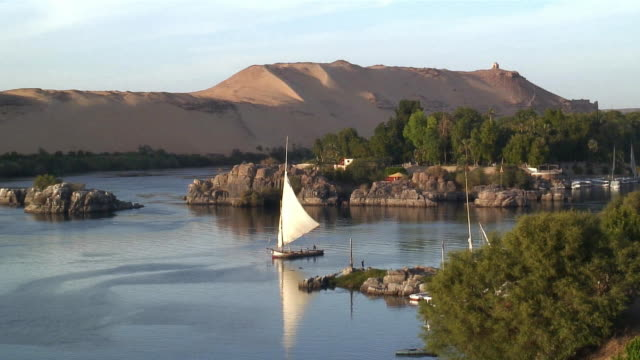 WS Traditional felucca boats sailing on Nile river near Aswan / Egypt