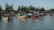 BOAT POV WS Traditional Fishing Boats Floating in Water / Vietnam