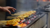 CU Traditional Malaysian satay being fanned and  cooked