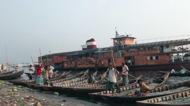 Traditional paddle steamer (the rocket) passing the river Buriganga near Sadarghat Boat Terminal, Dhaka, Bangladesh, Indian Sub-Continent, Asia