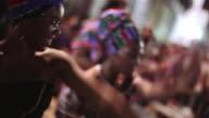 Traditional samba dancers move in sync to Brazilian drum music