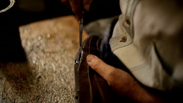 Traditional Shoemaker sticking The Shoe