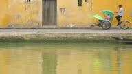 WS Traditional trishaws next to river