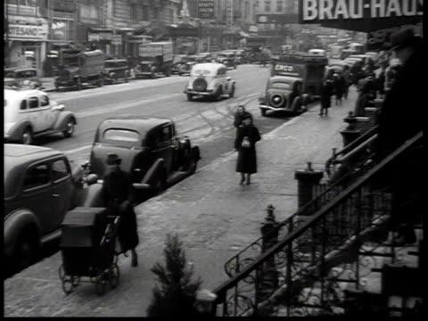 1938 HA traffic along 86th Street in New York City's German-American neighborhood, with sign for the Brau-Haus / New York, USA