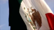 Traffic along More traffic along police siren heard SOT Juarez state justice building Coat of Arms on building Police officer wearing sombrero on...
