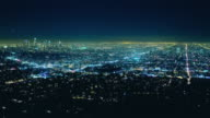 T/L HA WS Traffic and lights moving across Los Angeles Basin at night with view of downtown skyline / Los Angeles, California, USA