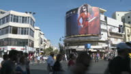 WS PAN Traffic and pedestrians crossing road intersection / Tel Aviv, Israel
