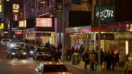 MS Traffic and pedestrians mingling in the Broadway Theater District / New York City, New York, United States