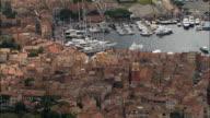 AERIAL Traffic and pedestrians pass through busy harbor/ Saint-Tropez, France