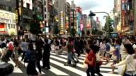 Traffic and People Crossing the Road in Shinjuku Japan