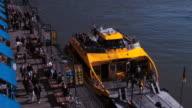 Traffic around boat docked at harbor