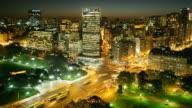 T/L, HA, Traffic at busy intersection on Avenida del Libertador at night, Buenos Aires, Argentina