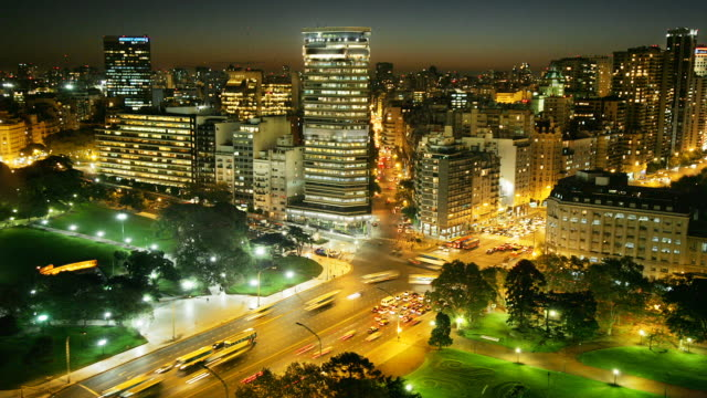 T/L, HA, Traffic at busy intersection on Avenida del Libertador at night, Buenos Aires, Argentina