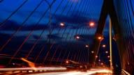 traffic car on bridge at sunset timelapse.