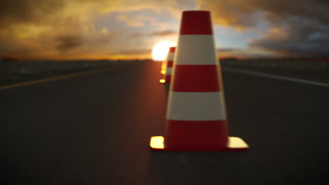 Traffic cone endless slalom in sunset. Car on highway .