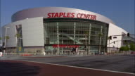 Traffic drives by the Staples Center in Los Angeles, California.