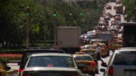 Traffic drives through traffic signals on Park Avenue.