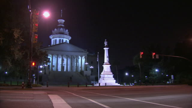 WS Traffic driving past South Carolina State Capitol at night / Columbia, South Carolina, United States