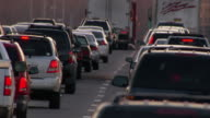 Traffic fills a highway at rush hour.