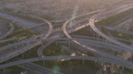 AERIAL Traffic flowing on complex highway interchange / Los Angeles, California, United States