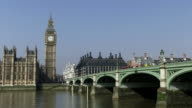 MS Traffic flowing on westminster bridge in front of big ben tower / London, England, Great Britain