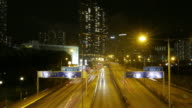 Traffic in downtown Hong Kong at night, tilt down time lapse.