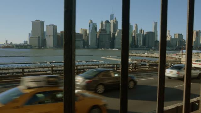 Traffic in foreground Downtown Manhattan New York background