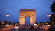 WS Traffic in front of Arc De Triomphe at dusk / Paris, France