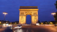 T/L WS ZI Traffic in front of Arc De Triomphe, dusk to night / Paris, France