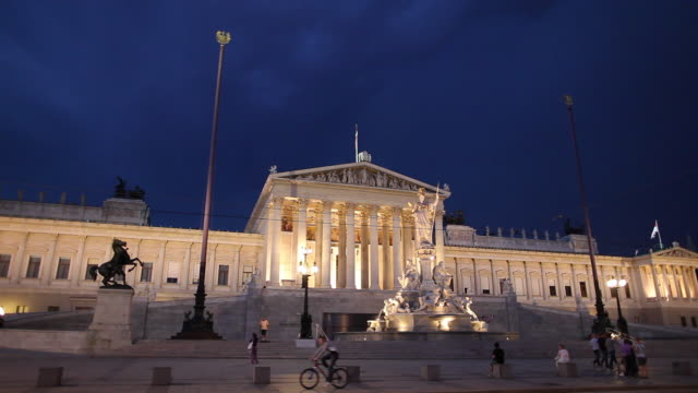 WS Traffic in front of Austrian Parliament Building during storm at night / Vienna, Austria