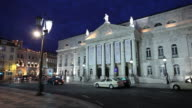 WS Traffic in front of National Theatre D. Maria II illuminated at night/ Lisbon, Portugal