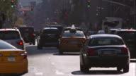 Traffic in Manhattan travels down a busy 7th Avenue.