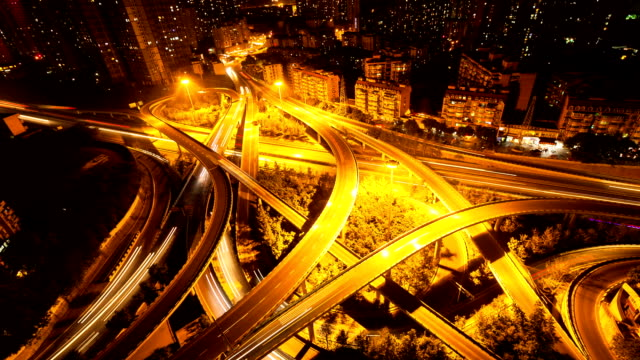 traffic light trail on road intersection of modern city chongqing,at night, timelapse.