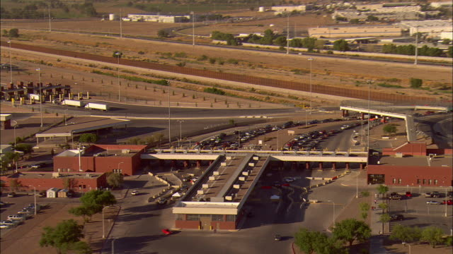 AERIAL Traffic lined up at border crossing at US/Mexican border crossing, El Paso, Texas, USA