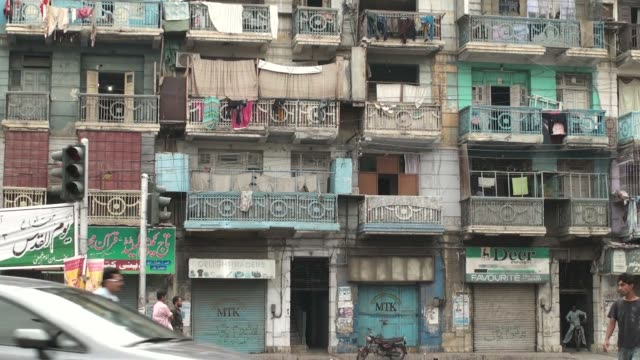 Traffic move past an old building at MA Jinnah Road in Karachi Pakistan Traffic moves along a street in the residential area in Karachi